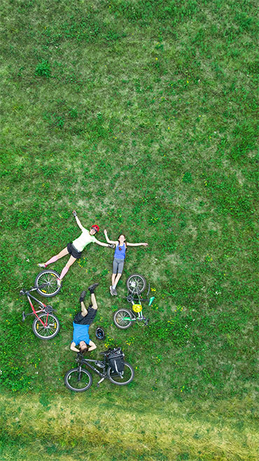 decorative people laying in the grass
